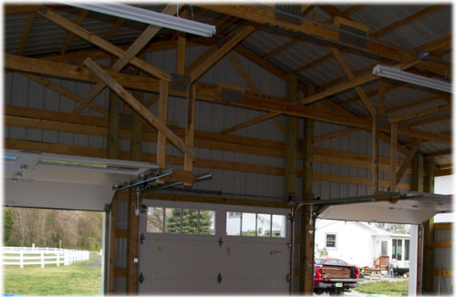Installing overhead door rails in pole barn