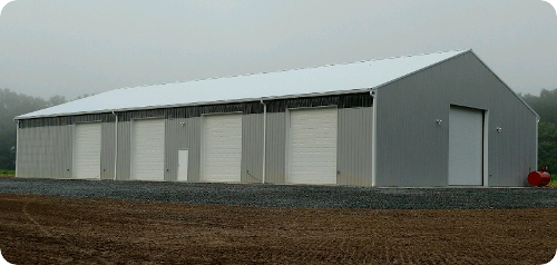 Commercial equipment storage buildings new york pole barns for Pole barn roof pitch